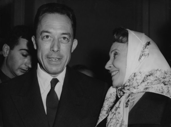 French actress Madeleine Renaud, right, congratulates French writer Albert Camus, after he was officially announced as winner of the Nobel Prize for literature, at the Gallimard book publishers in Paris, France, October 17, 1957. Photo by Godot/Associate Press.