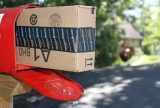 A box containing an order from Amazon.com is shown after it was delivered to a house in Etters, Pa, Sept. 16, 2005. The rapid growth of digitization and e-commerce is rendering many long-time trade practices and policies obsolete. Photo by John Zeedick/Associated Press.