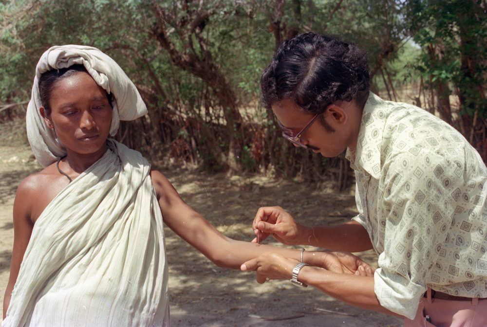 A woman receives a vaccination against smallpox as Indian medical teams arrive at Hakegora village to inoculate people, June 12, 1974. Photo by Associated Press.