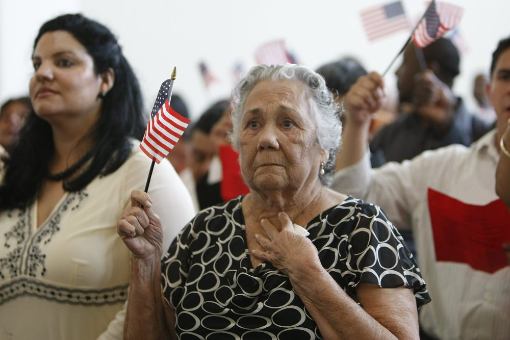 An unidentified woman from Cuba, one of the 196 people from 24 countries, reacts during naturalization ceremonies in Miami, July 1, 2009. Photo by J. Pat Carter/Associated Press.