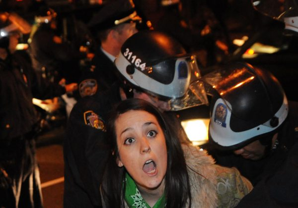 An Occupy Wall Street protester is arrested by police in New York City, Jan. 1, 2012. Photo by Stephanie Keith/Associated Press.