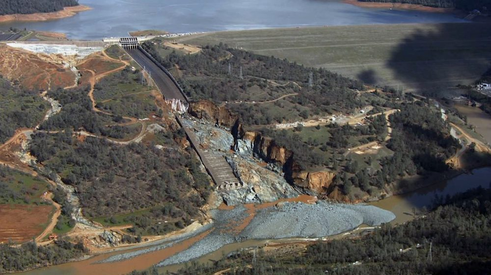 A Feb. 27, 2017 image of the Oroville Dam, the nation's tallest, after heavy rainfall forced authorities to release water down a damaged spillway. The incident raised questions about California state spending on public infrastructure. Photo by KCRA/Associated Press.