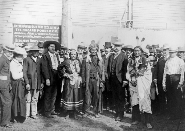 """Lillian Smith as Princess Wenona, taken at the 1901 World's Fair in Buffalo, New York. Centered in the photo is Geronimo. An inscription on the photo says, """"General Milles–Indian Congress,"""" probably meant to commemorate General Nelson Miles's winning of Geronimo's surrender in 1886. Image courtesy of Library of Congress."""