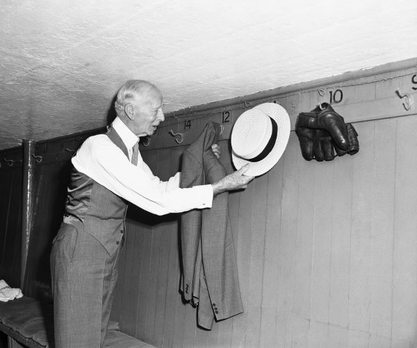The ever-formal Connie Mack hung up his hat and coat in the dugout at Yankee Stadium on August 10, 1950. Photo by Murray Becker/Associated Press.