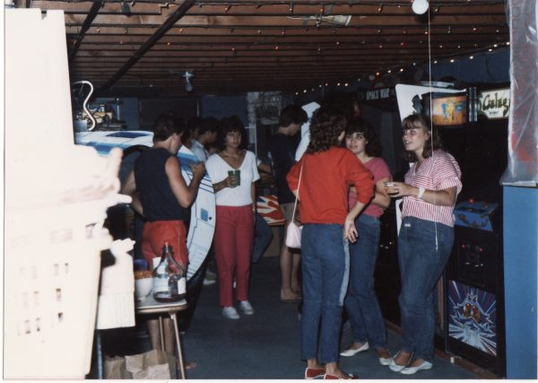 Teens partying in a family basement with video games in 1985. Photo courtesy of Richie Wiebke.