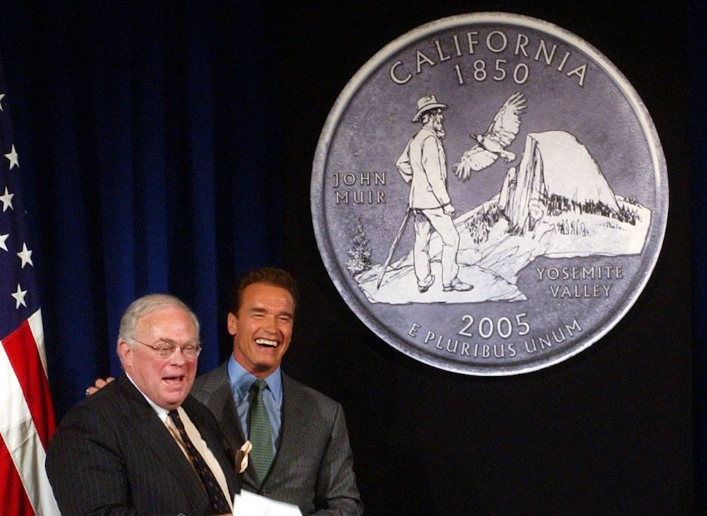 Kevin Starr, the former State Librarian and author of an influential and critically acclaimed multi-volume history of California, with then-Gov. Arnold Schwarzenegger, unveiling the design chosen for the California Quarter during ceremonies in Sacramento on March 29, 2004. Photo by Rich Pedroncelli/Associated Press.