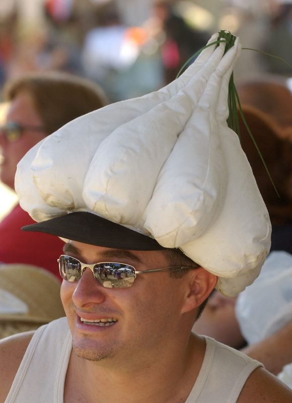 Don't forget the Listerine: Jerry Hernandez wears a garlic-shaped hat as he listens to a live band at the Gilroy Garlic Festival in Gilroy, Calif. on July 24, 2004. Photo by Marcio Jose Sanchez/Associated Press.