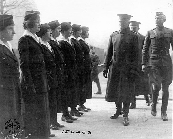 "U.S. General John ""Black Jack"" Pershing inspects switchboard operators serving in occupied Germany. Women remained on duty until discharged after World War I ended in November 1918. The last women were relieved in 1920. Photo courtesy of National Archives and Records Administration."