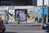 In California, art can break out practically anywhere. That includes a downtown Los Angeles street, where an anti-gridlock traffic lane opens up impromptu street performance art possibilities. Photo courtesy of Krocky Meshkin/Flickr.