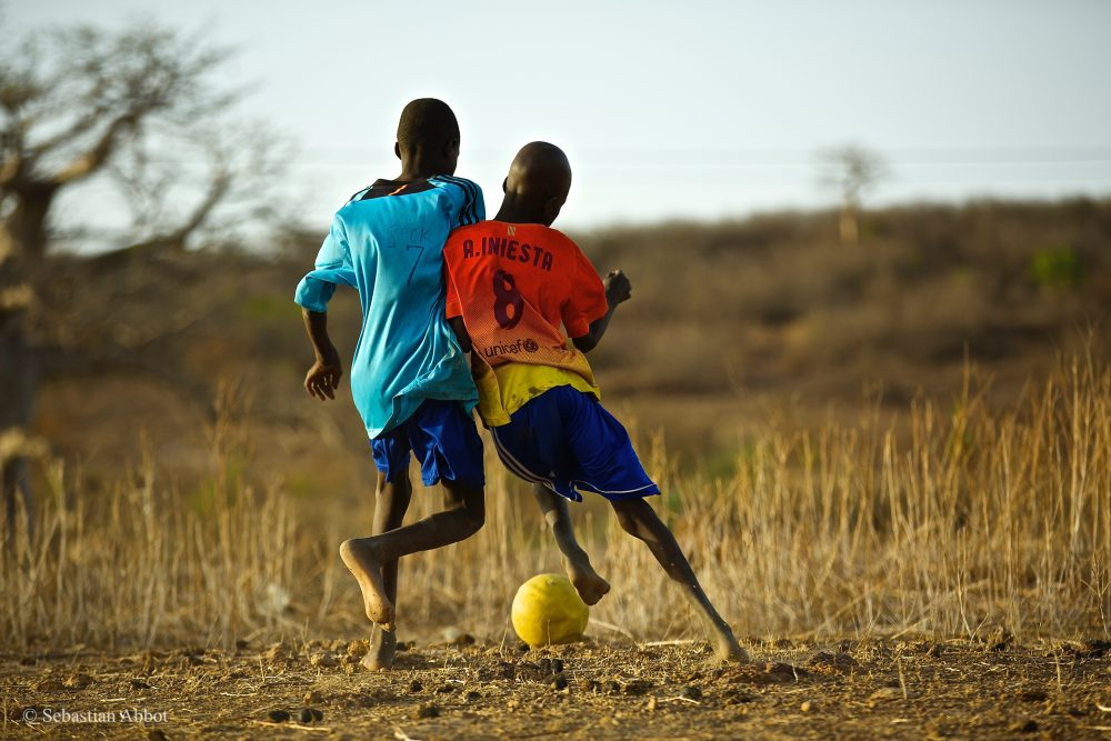 Are International Soccer Moguls Preying On The Dreams Of The Worlds  Battling For The Ball During A Pickup Game In Senegal Photo Courtesy Of  Sebastian Abbot A Healthy Mind In A Healthy Body Essay also Environmental Science Essays  Thesis Statement Examples For Persuasive Essays